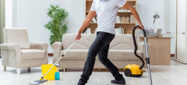 Man doing five cleaning chores at a time.