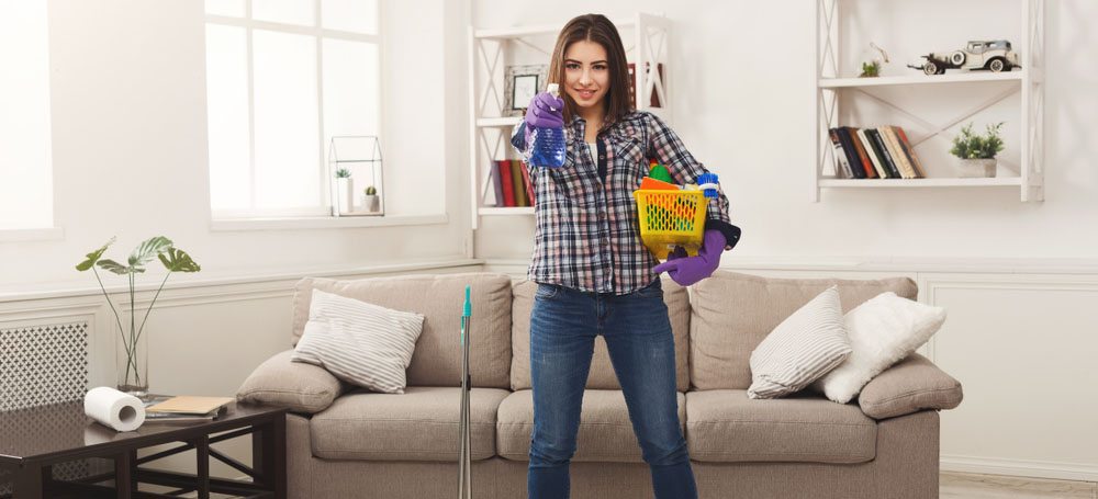 Woman prepared to tackle hers spring cleaning checklist.