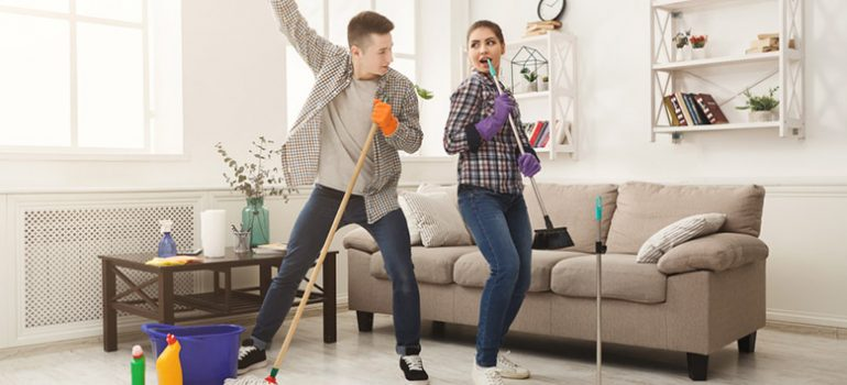 Young couple decluttering their home during spring cleaning!